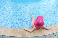 enjoying a swimming pool Stock Photography