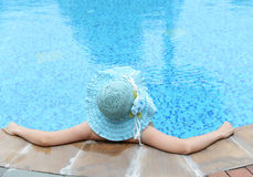 enjoying a swimming pool Royalty Free Stock Images