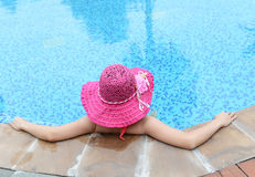 enjoying a swimming pool Stock Images