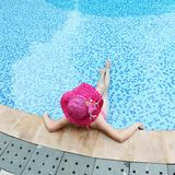 enjoying a swimming pool Royalty Free Stock Photos