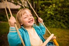 Enjoying swinging Stock Photo