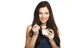 Enjoying taste of yogurt. Young female enjoying taste of yogurt isolated on white Royalty Free Stock Photography