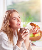 Enjoying tasty morning meal Stock Photography