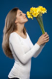 Enjoying The Smell Of Flowers Royalty Free Stock Images