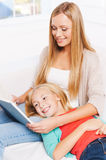 Enjoying their favorite book together. Royalty Free Stock Photo