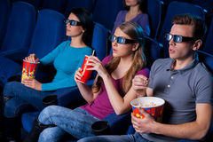 Enjoying three-dimensional movie. Stock Photography