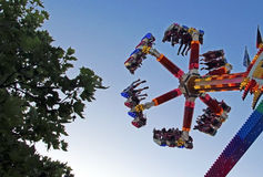Enjoying a thrill ride in an amusement park Royalty Free Stock Photography