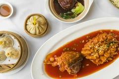Traditional Shanghai food including dumplings, stewed meatball and mandarin fish Royalty Free Stock Image