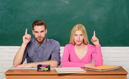 Enjoying university life. Guy and girl sit at desk in classroom. Correct answer on their mind. Studying in college or. University. Apply for free program royalty free stock image