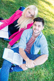 Enjoying university life. Student girl and boy student holding b Stock Photography