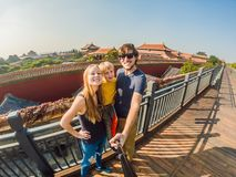 Free Enjoying Vacation In China. Happy Family With National Chinese Flag In Forbidden City. Travel To China With Kids Concept Royalty Free Stock Photo - 135997865