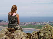 Enjoying the view. A female hiker stops to enjoy the view of Llandudno from Conwy Mountain Royalty Free Stock Images