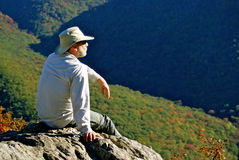 Enjoying a View. A man sits on a rock and enjoys the view in the Berkshire Hills, Massachusetts Stock Photos