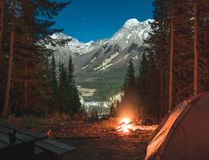 Enjoying a warm fire at a campsite overlooking Wapta Falls. At a free camp site royalty free stock photo