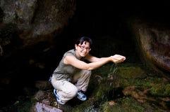 Enjoying water in mountains Stock Images