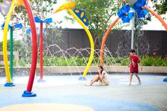 Enjoying the waterpark on a hot day. Brother and his sister enjoying the waterpark on a hot day Stock Photo