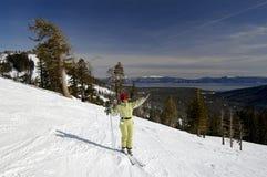 Enjoying The Winter. A young attractive woman enjoys the winter at a ski resort at northern Lake Tahoe, California Royalty Free Stock Image