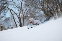Enjoying winter sledding Royalty Free Stock Photo