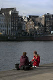 Enjoying the winter sun at the amstel in Amsterdam. Amsterdam,The Netherlands-march 7,2015: Enjoying the winter sun at the amstel in Amsterdam and pick nick Stock Photography