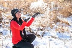 Enjoying winter - woman throwing snow Royalty Free Stock Photos