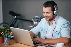 Enjoying work and good music. Royalty Free Stock Photography