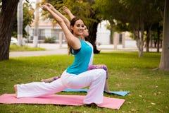 Enjoying yoga outdoors Royalty Free Stock Photo