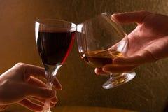 Enjoyment. Wine Cognac Brandy Restaurant Human Hand Drink Dark background Stock Images