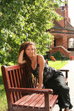 Enjoyment. Happy young woman relaxing in the park Stock Image