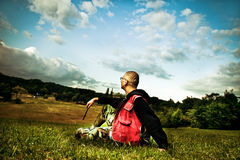 Enjoyment. Adult man sitting in field and enjoy in view Stock Photo