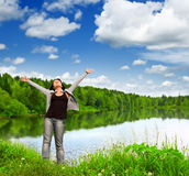 Enjoyment. Young woman near the lake Royalty Free Stock Images
