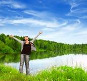Enjoyment. Young woman near the lake Royalty Free Stock Image