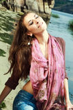 Enjoyment. A brunette enjoy the sunlight on the coast of the river Stock Image