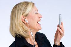 Enjoyment. Happy business woman is listening to music stock image