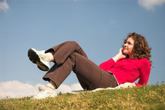 Enjoyment!. Young female is lying on grass field stock photo