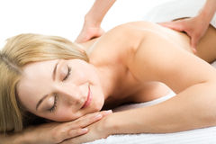 Enjoyment. Image of pretty woman getting a massage therapy and enjoyment Royalty Free Stock Photos