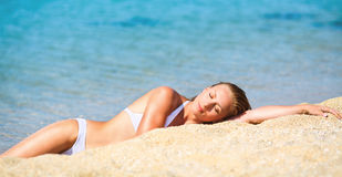 Enjoyment on the beach. Young beautiful woman enjoying and relaxing on the sand beach Royalty Free Stock Image