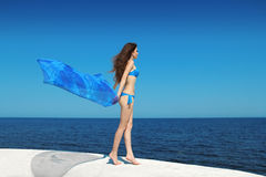 Enjoyment. Bikini model woman with blowing tissue over blue sky, Royalty Free Stock Images