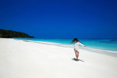 Enjoyment. Carefree happy woman open arms on tropical beach, exo Royalty Free Stock Photo