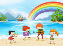 Enjoyment. Children singing and dancing at the beach side Royalty Free Stock Photo