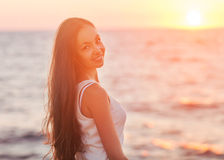 Enjoyment - free happy woman enjoying sunset. Stock Photos