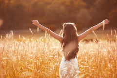 Enjoyment. Free woman arms outstretched. Happy bride with long w Royalty Free Stock Photos