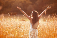 Enjoyment. Free woman arms outstretched. Happy bride with long w Stock Photography