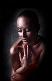 Enjoyment. Glossy Woman with Golden Body Art. Glamor Royalty Free Stock Photography