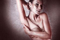 Enjoyment. Glossy Woman with Golden Body Art. Glamor Royalty Free Stock Image