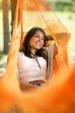 Enjoyment in hammock. Enjoyment in orange hammock in nature Stock Image