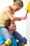 Enjoyment in housework. Men carries his wife piggyback stock photography