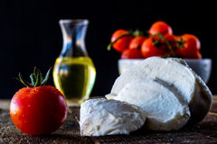 Enjoyment of Italian food. Tomatoes, olive oil and mozarella on a wooden table Stock Photography