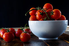 Enjoyment of Italian food. Wet tomatoes on an old table Stock Images