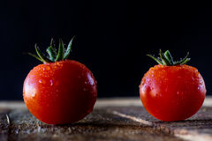 Enjoyment of Italian food. Wet tomatoes on an old table Stock Photo