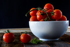 Enjoyment of Italian food. Wet tomatoes on an old table Royalty Free Stock Image